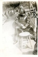 Old b/w photo man on deck in full rain gear ship boat fisherman? Niagara Falls?