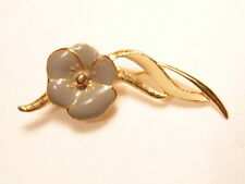 Gold colored fashion pin with enameled flower