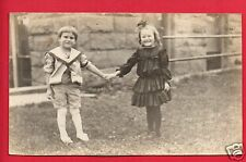 RPPC YOUNG BOY AND GIRL HOLDING HANDS PAULINE BLAIR AND DONALD RPPC