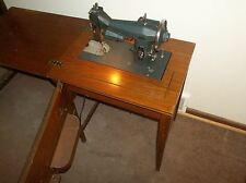 VINTAGE SEARS-ROEBUCK KENMORE ROTARY SEWING MACHINE, MODEL 117-522 AND CABINET