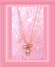 A00010A - Gold metal and pearl chain with eye catching gold bow and a pearl neck