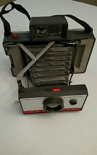 Vintage Polaroid 104 land Camara, flash # 268 and cold case # 193