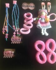 A 17 Piece Pack Of Pink Hair Ponio Bobbles And Clips