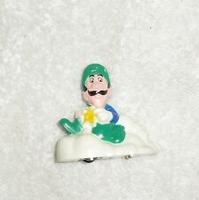 Vintage Luigi toy from Nintendo, 1989, Plastic, 2 1/4 inches tall and wide