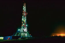 799025 Oil Drilling Rig At Night A4 Photo Print