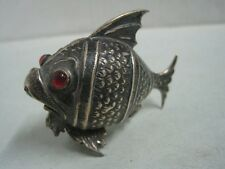 Antique Silver salt shaker or Pepper shaker shaped fish with red eyes
