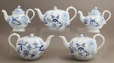 Group of Five Meissen Porcelain Tea and Coffee Pots, 20th c., with bl... Lot 470
