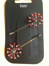 A Pair Of Pretty Metal With Red Stones Starburst Design Hair Grips