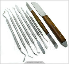 Dental lab Technican sculpting pk thomas cire et carver modeling surgical tool