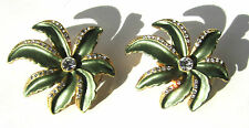 Palm looking green gold and faux diamond clip on earrings. Just under 1-1/2""
