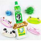HOT Bathroom Home Tube Rolling Holder Squeezer Easy Cartoon Toothpaste Dispenser