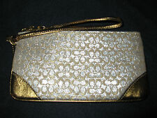 NWT COACH FS7154 GOLD SIGNATURE LUREX WITH PINK LINING WRISTLET