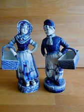 PAIR OF EARLY 20TH CENTURY DUTCH DELFT FIGURES WITH BASKETS