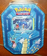 Pokemon Trading Card Game in Tin w/GYARADOS Card + 3 TCG Booster Packs (2016)