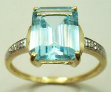 10KT YELLOW GOLD OCTAGON BLUE TOPAZ & DIAMOND RING   SIZE 7    R1257