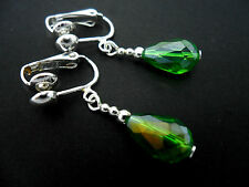 A PAIR OF SHORT GREEN GLASS   CRYSTAL TEARDROP CLIP ON  EARRINGS. NEW.