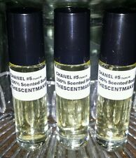Chanel #5 100% Scented Body Oil 1oz. in 3 roll-on bottles.
