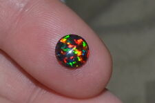 Gorgeous 0.61ct 7mm Round Cab Black Opal w/ Great Color Play!!!