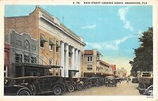 c.1920 Stores Old Cars Main St. looking North Bradenton FL post card