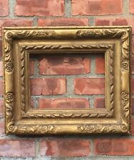 19th Century Carved And Gilded Picture Frame With Rose Ornaments. Corner Splines