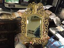 Antique brass over iron B&H Bradley and Hubbard fancy Bacchus face wall mirror