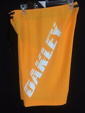 Men's orange and white Oakley board shorts  Size 30 inseam 11 New with Tags