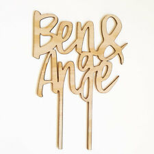Custom timber wedding cake topper. Personalised wooden wedding decor.