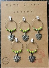 wine glass charms. set of 5. Green Man.
