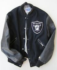 OAKLAND RAIDERS STARTER JACKET with leather sleeves.  Late 1980's.