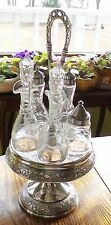 REEDS & BARTON 6 CRYSTAL ETCHED CRUETS IN SILVER PLATED REPROUSSE STAND