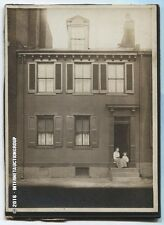 VINTAGE PHOTO, WOMAN AND CHILD ON FRONT STOOP. URBAN SCENE