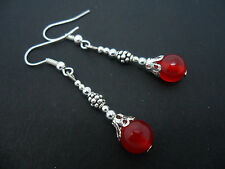 A PAIR OF DANGLY SILVER PLATED RED JADE BEAD   EARRINGS. NEW.