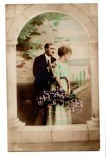 RPPC real photo young couple in love hand tinted flowers St.Catherines, ONT.