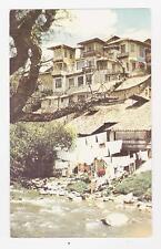 Cuenca,Ecuador,S.A.El rio Tomebamba y sus testigos, las Casas Colgantes,c.1909
