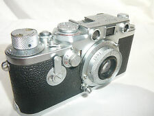 Leica IIIf with its case with Elmar 3.5 50mm lens