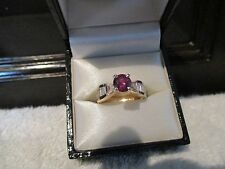 14 Kt Yellow Gold Round Red Ruby with Baguettes and Trillion cut Diamond Ring
