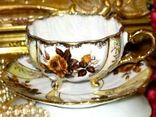 JAPAN 3 FOOTED YELLOW ROSES & YELLOW IRIDESCENT GOLD TEA CUP AND SAUCER