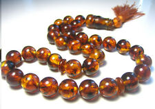 Baltic amber islamic rosary. 33 round beads  12.mm. 34.4gr