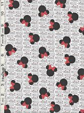 Disney Minnie Mouse Heads Bows & Words Fabric by Springs Creative bty