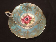A2136/1 PARAGON MADE IN ENGLAND LT. BLUE AND GOLD TEA CUP AND SAUCER RED FLOWER