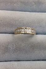 14K Yellow Gold Band With A Row Of Round Diamonds