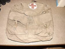 two military medic Red Cross back packs
