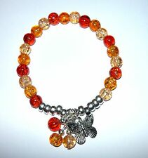 PRETTY CRACKLE BEADS STRETCH BRACELET IN SHADES OF AMBER WITH BUTTERFLY DROP