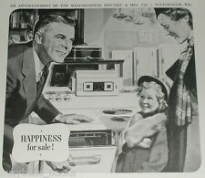 1938 Westinghouse ad, Electric stove with central clock