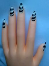 Full cover fake nails, stiletto, pointy, claw. Black and white stripes. Jailbird