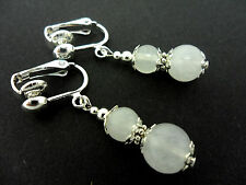 A PAIR OF DANGLY WHITE JADE  CLIP ON EARRINGS. NEW.