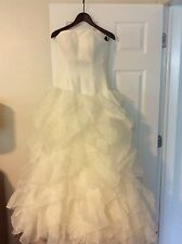 Wedding Dress Ivory Size 10 accented with Ruffled Train and Bows in the back