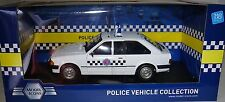 MODEL ICONS  999005  FORD ESCORT 1.1L  SECTION ESSEX  POLICE CAR, 1:18 SCALE