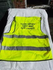 """High-visibility safety vest tabard """"SLOW DOWN"""" safety slogan"""