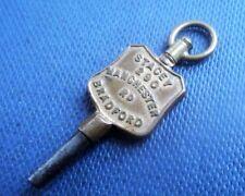 Advertising Pocket Watch Key - Stacey , 290 Manchester Rd , Bradford , Yorkshire